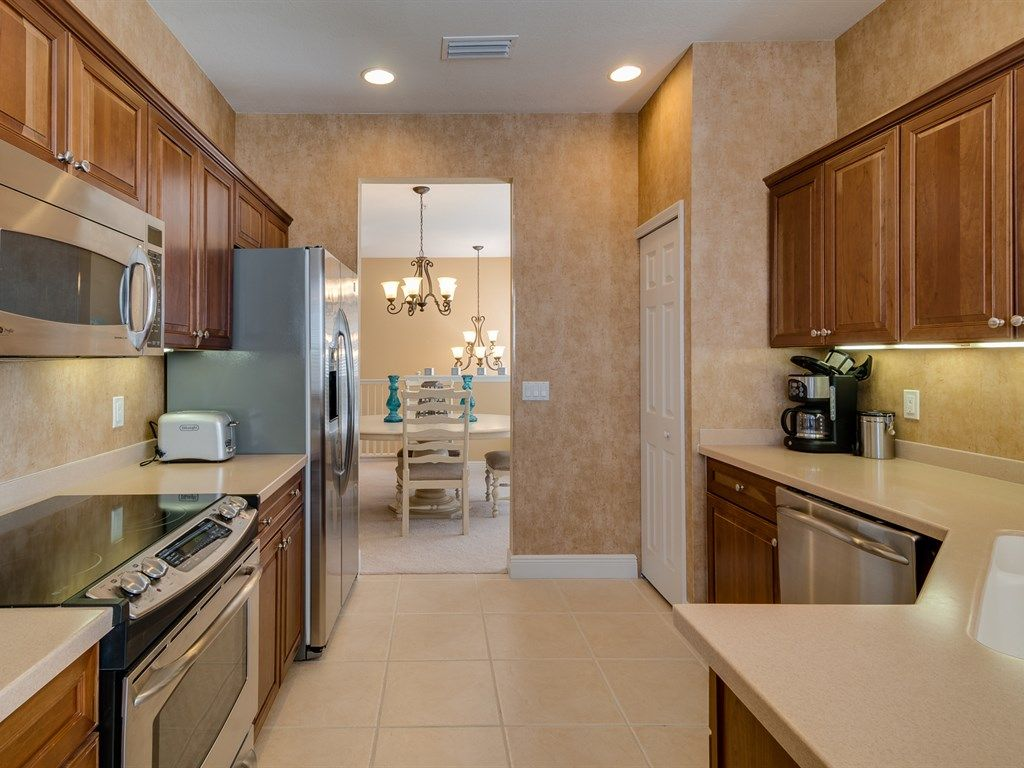 Craftsman kitchen with high ceiling flush in venice fl for Kitchen cabinets venice fl