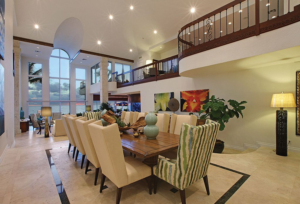 Contemporary Dining Room with can lights, sandstone tile floors, stone tile floors, Columns, Balcony, High ceiling