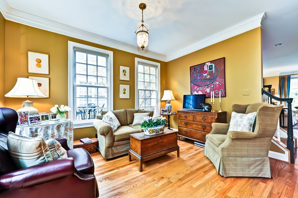Traditional Living Room with double-hung window, Crown molding, flush light, Hardwood floors, Standard height