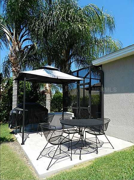 Traditional Patio with exterior tile floors, Outdoor kitchen, Transom window, French doors, exterior concrete tile floors