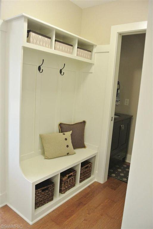 Traditional Mud Room with Built-in bookshelf, Hardwood floors, Standard height