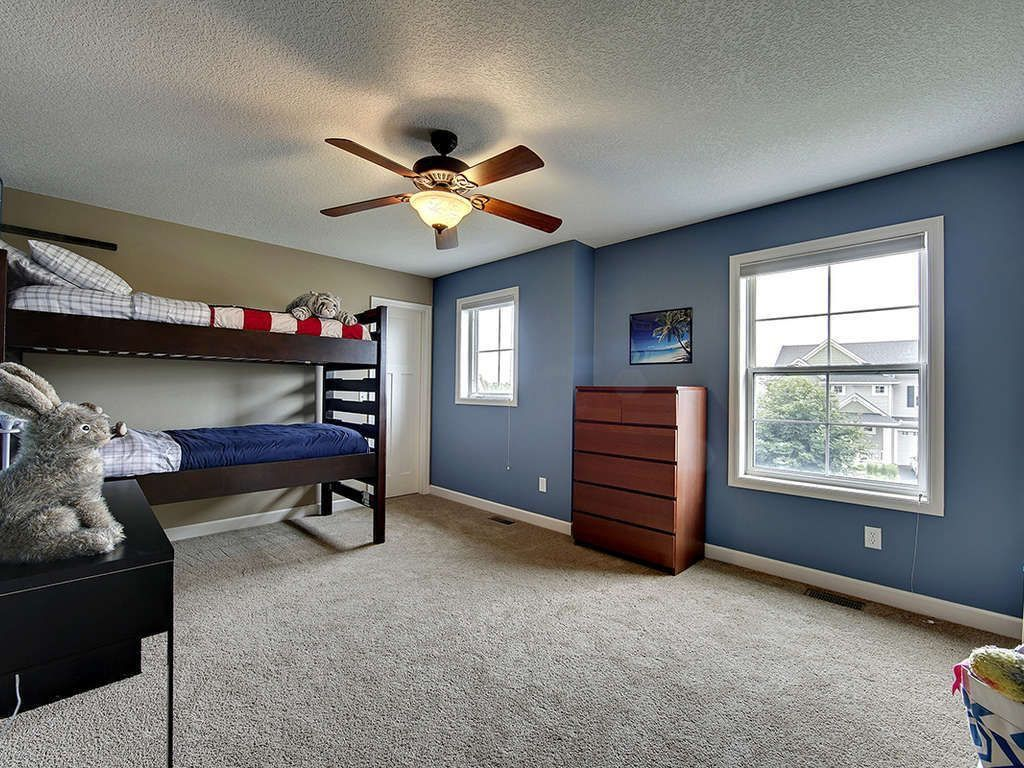 Traditional Kids Bedroom with double-hung window, no bedroom feature, Standard height, specialty door, Carpet, Ceiling fan