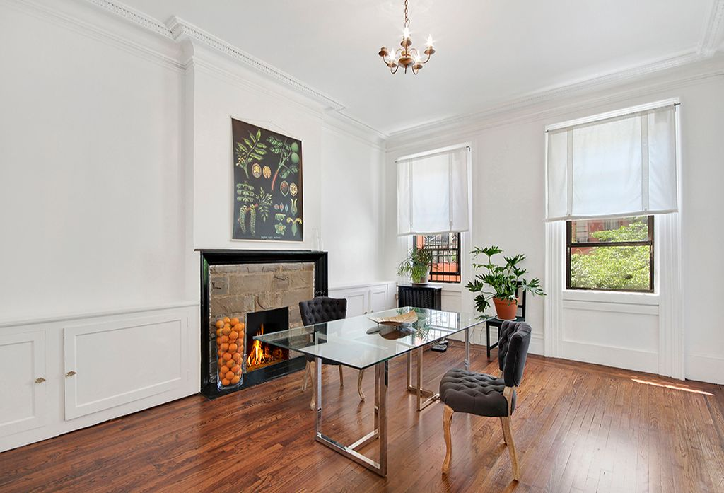 Contemporary Home Office with Chair rail, Crown molding, Built-in bookshelf, stone fireplace, Hardwood floors, Chandelier