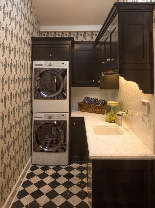 Traditional Laundry Room with Built-in bookshelf, interior wallpaper, Dark stained cabinets, simple marble tile floors