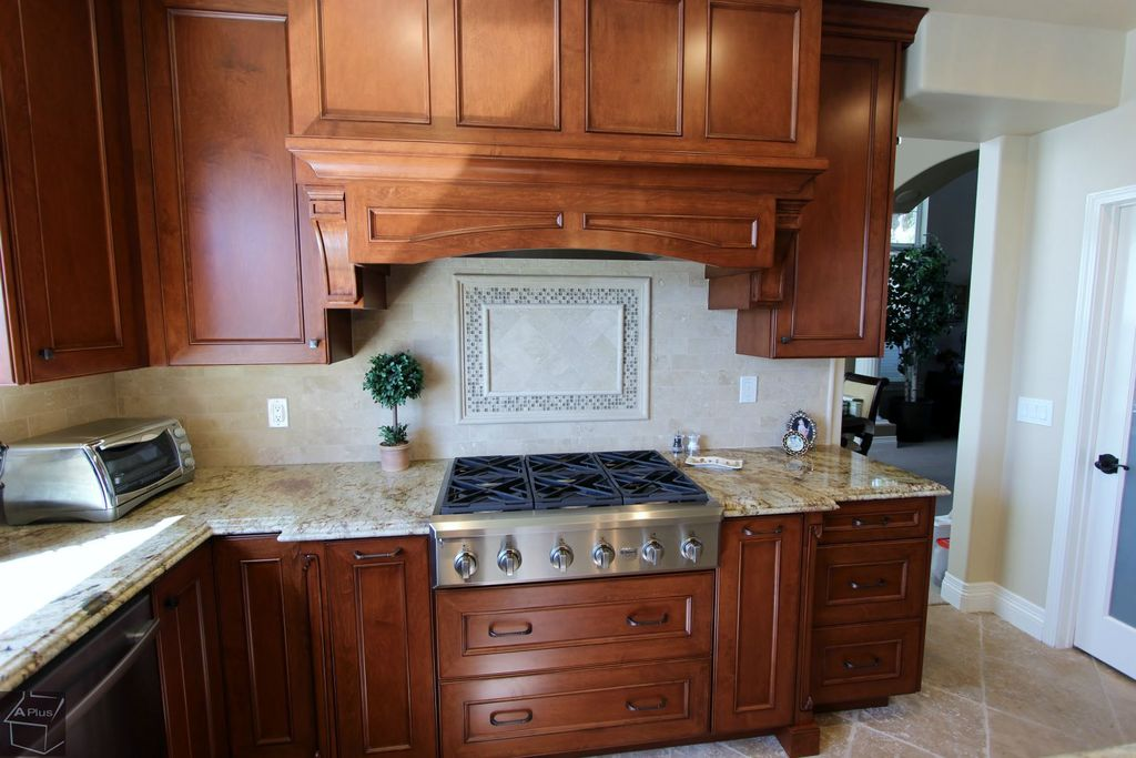 Traditional Kitchen with Framed Partial Panel, Custom hood, dishwasher, Flat panel cabinets, Standard height, French doors