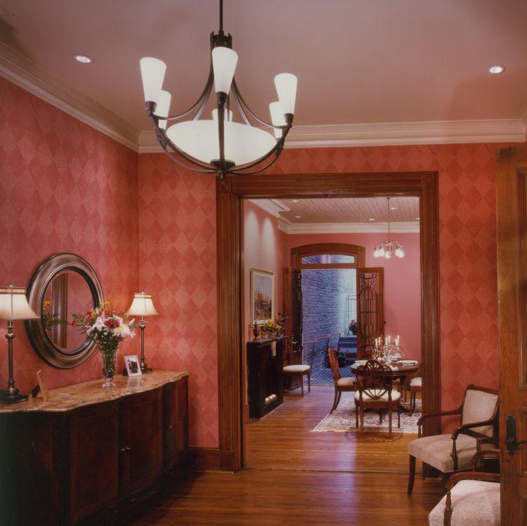 Traditional Living Room with Built-in bookshelf, can lights, Hardwood floors, specialty door, flush light, Crown molding