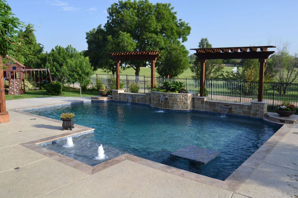 Craftsman Swimming Pool with Pool with hot tub, Trellis, Pathway, Raised beds, Fence, Fountain, exterior stone floors