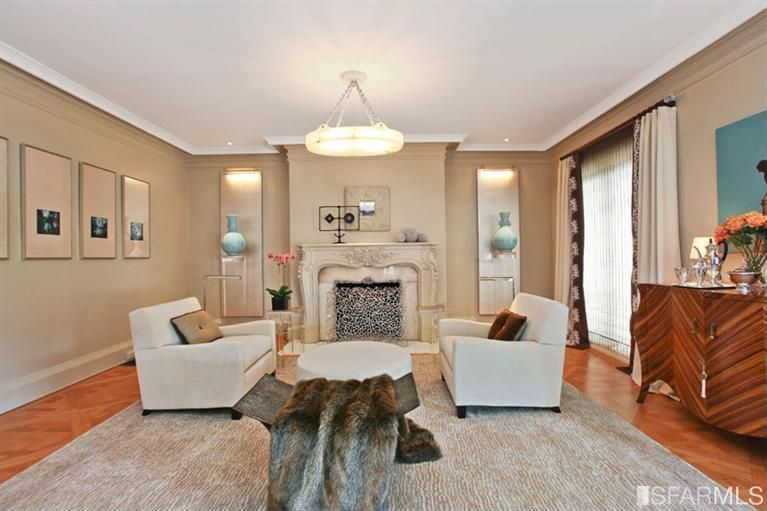 Traditional Living Room with bedroom reading light, Fireplace, Crown molding, can lights, stone fireplace, Hardwood floors