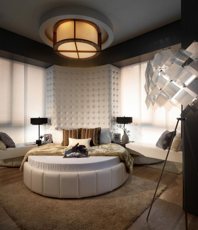 Contemporary Master Bedroom with Avant garde modern round white bed, Hardwood floors, flush light, Paint 1, Crown molding