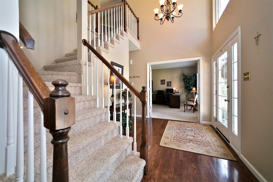 Traditional Entryway with Chandelier, Hardwood floors, French doors, High ceiling, picture window