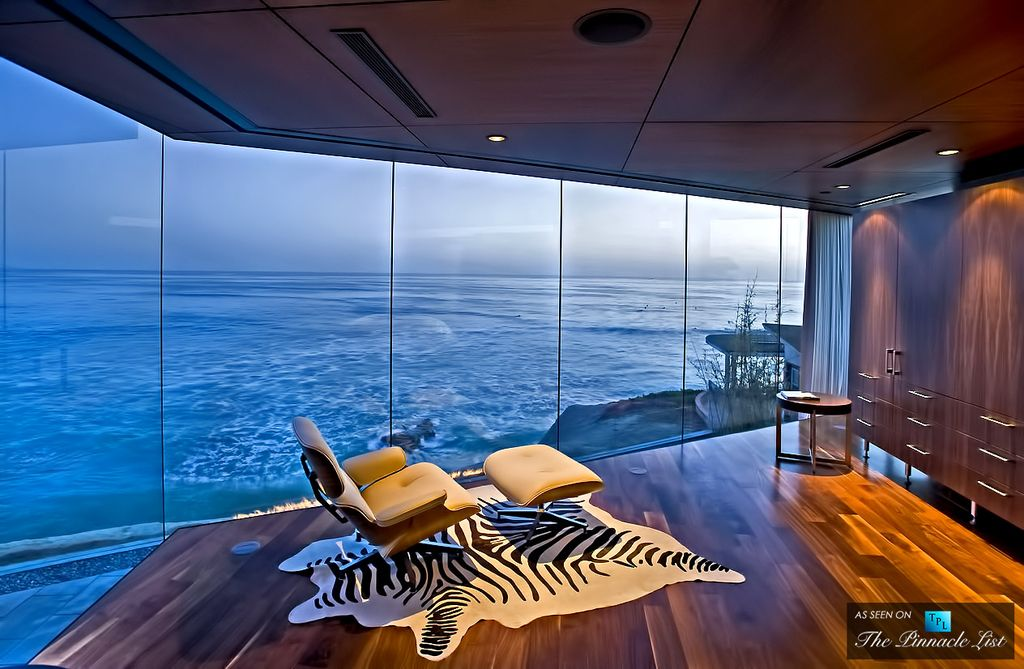 Contemporary Master Bedroom with picture window, Standard height, Hardwood floors, eCowhides Zebra Cowhide Rug, can lights