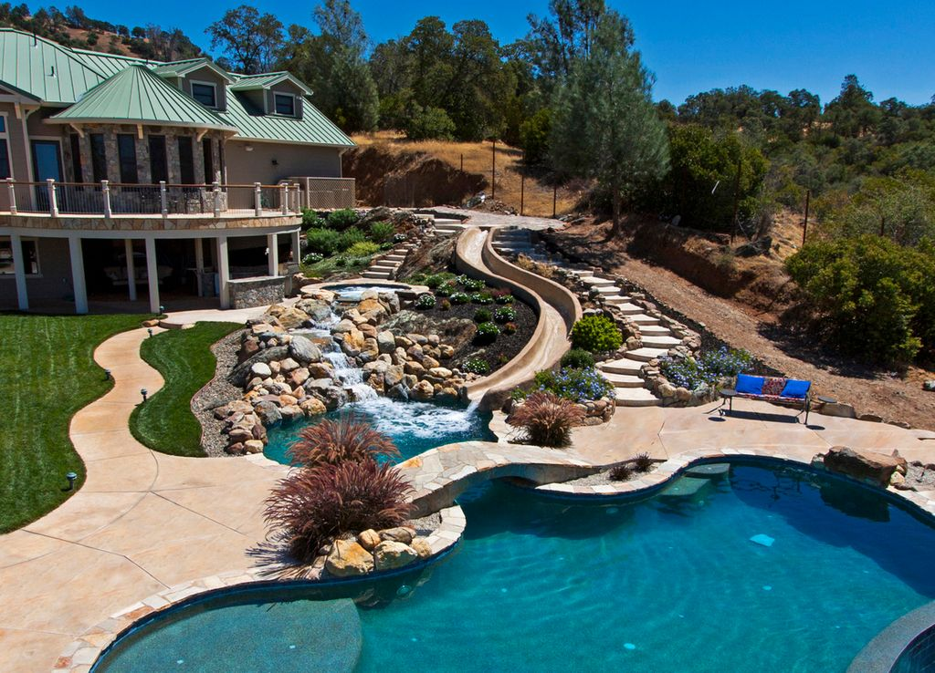 Rustic Swimming Pool With Water Feature Exterior Stone