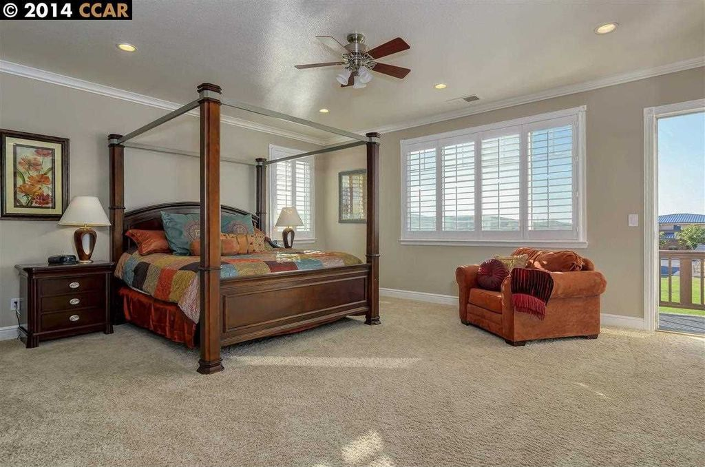 Traditional Master Bedroom with Standard height, Crown molding, Carpet, picture window, can lights, Ceiling fan