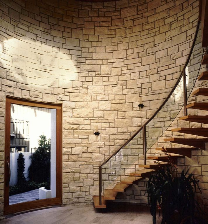 Contemporary Staircase with Wall sconce, French doors, High ceiling, curved staircase, Hardwood floors