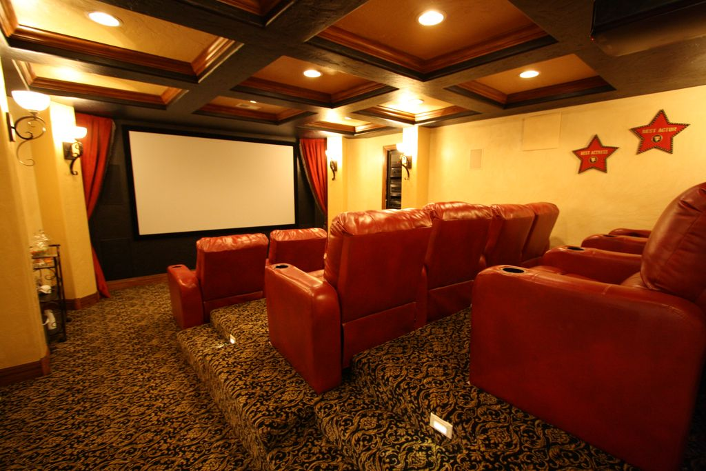 Traditional Home Theater with Exposed beam, specialty door, Carpet, can lights, Box ceiling, Wall sconce, Standard height