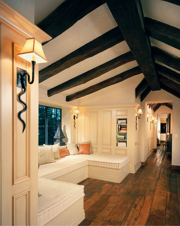 Traditional Hallway with Paint, Casement, Wall sconce, Cathedral ceiling, Decorative Pillow, Built-in bookshelf, Window seat