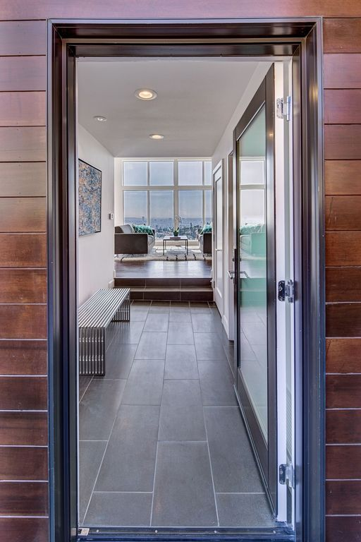 Contemporary Hallway with can lights, stone tile floors, Standard height, soapstone tile floors, French doors