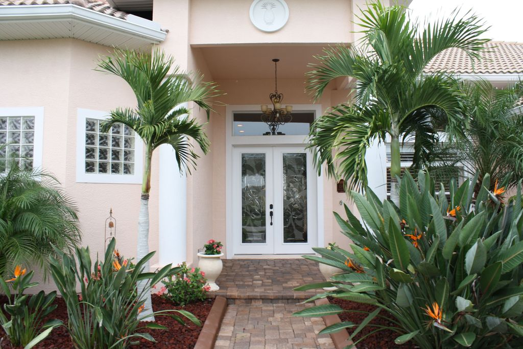 Tropical Front Door with French doors, exterior tile floors, exterior concrete tile floors, picture window, Pathway