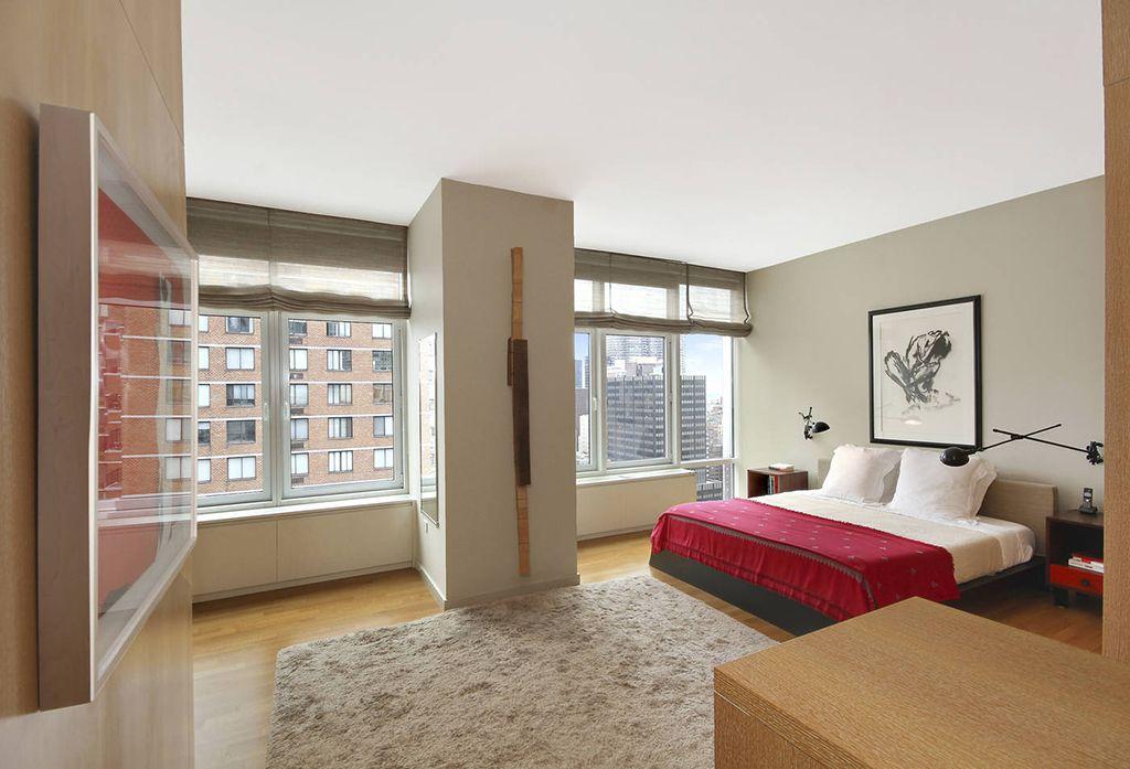 Contemporary Master Bedroom with Casement, Standard height, Hardwood floors, bedroom reading light