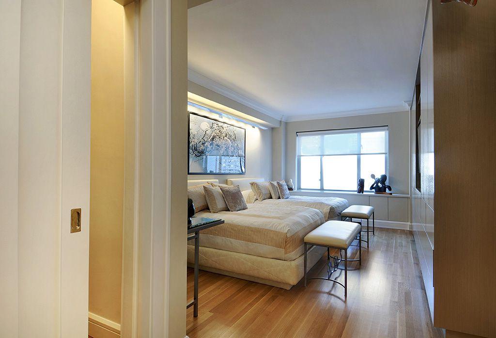 Contemporary Master Bedroom with Built-in bookshelf, Standard height, Crown molding, bedroom reading light, Casement