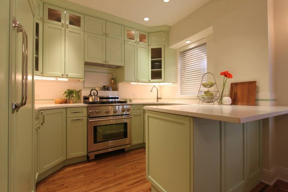 Eclectic Kitchen with Flush, Corian counters, can lights, Paint, gas range, specialty window, Kitchen peninsula, Glass panel