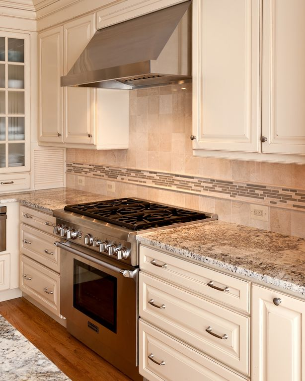 Traditional Kitchen with Stone Tile, Ceramic Tile, L-shaped, full backsplash, Complex granite counters, Standard height