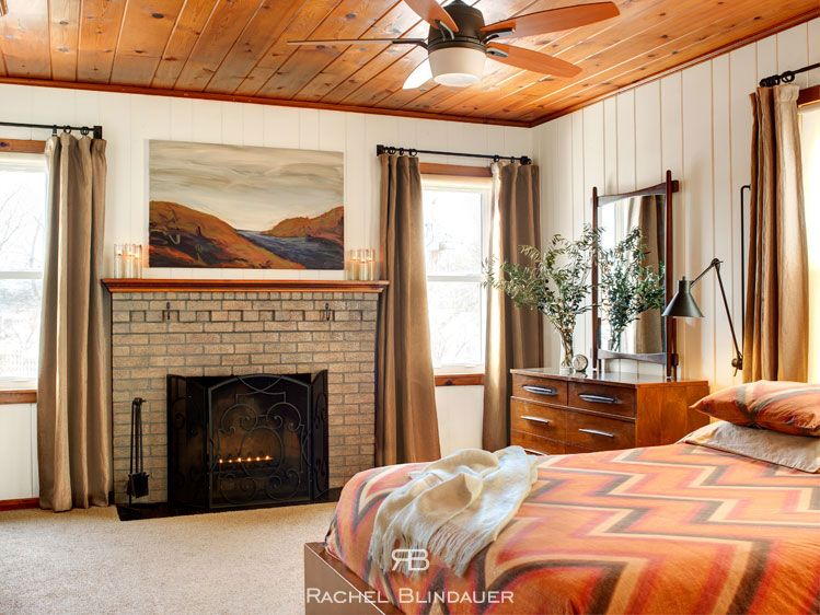 Eclectic Master Bedroom with flush light, Built-in bookshelf, Crown molding, double-hung window, Standard height, Fireplace