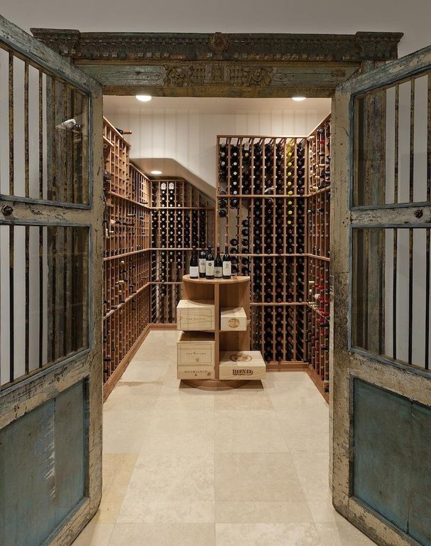 Wine Cellar with Glass panel door, Concrete tile , Built-in bookshelf, can lights, High ceiling