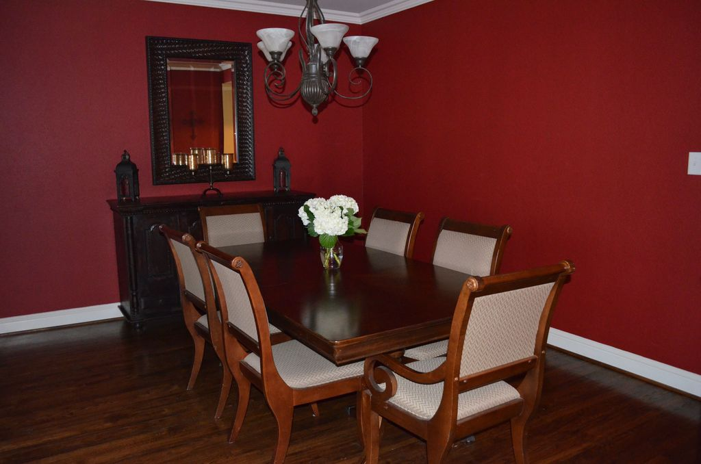 Traditional Dining Room with Wildon Home Hanover Arm Chair, Chandelier, Hardwood floors, Crown molding