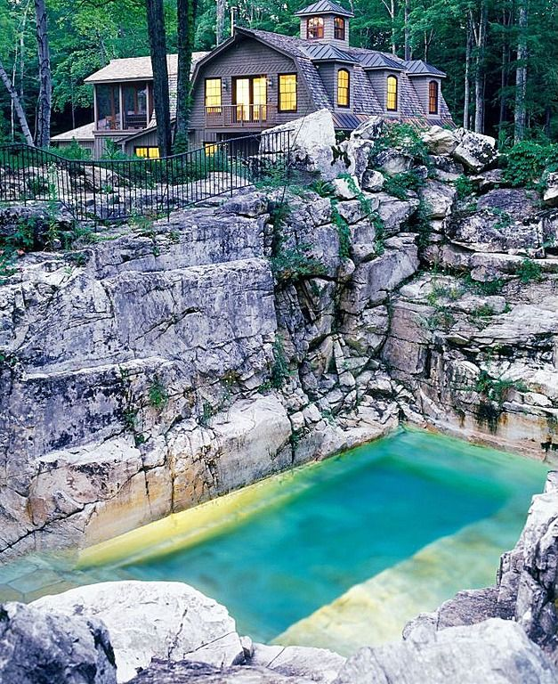 Rustic Swimming Pool with exterior stone floors, Other Pool Type, Deck Railing, Fence