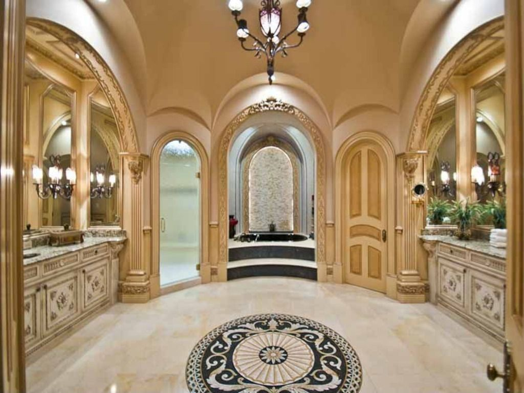 Mediterranean Master Bathroom with Undermount sink, Flush, stone tile floors, Flat panel cabinets, full backsplash, Shower