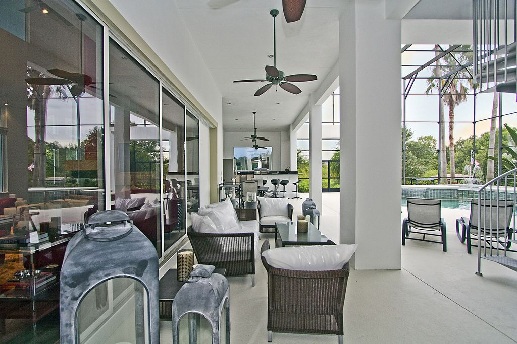 Modern Porch with Outdoor kitchen, Wrap around porch, Lap pool, sliding glass door, exterior tile floors, picture window