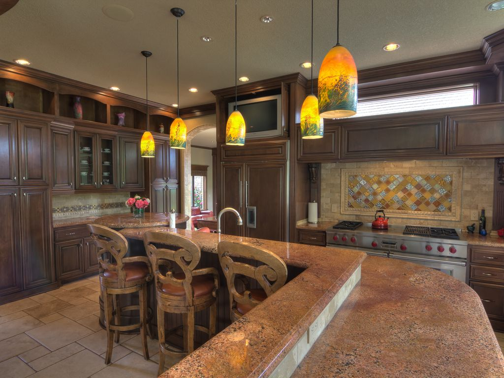 Mediterranean Kitchen with Pendant light, Limestone Tile, large ceramic tile floors, Ann sacks backsplash tile, Stone Tile