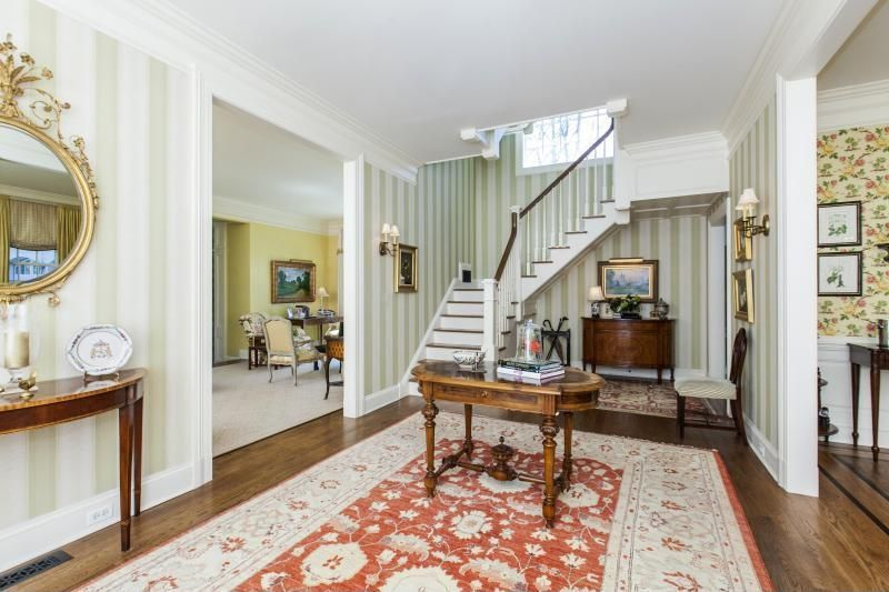 Traditional Entryway with Standard height, Crown molding, Hardwood floors, interior wallpaper