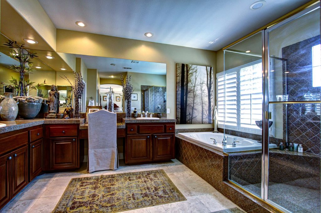Mediterranean master bathroom with simple granite tile counters inset cabinets in las vegas - Bathroom cabinets las vegas ...