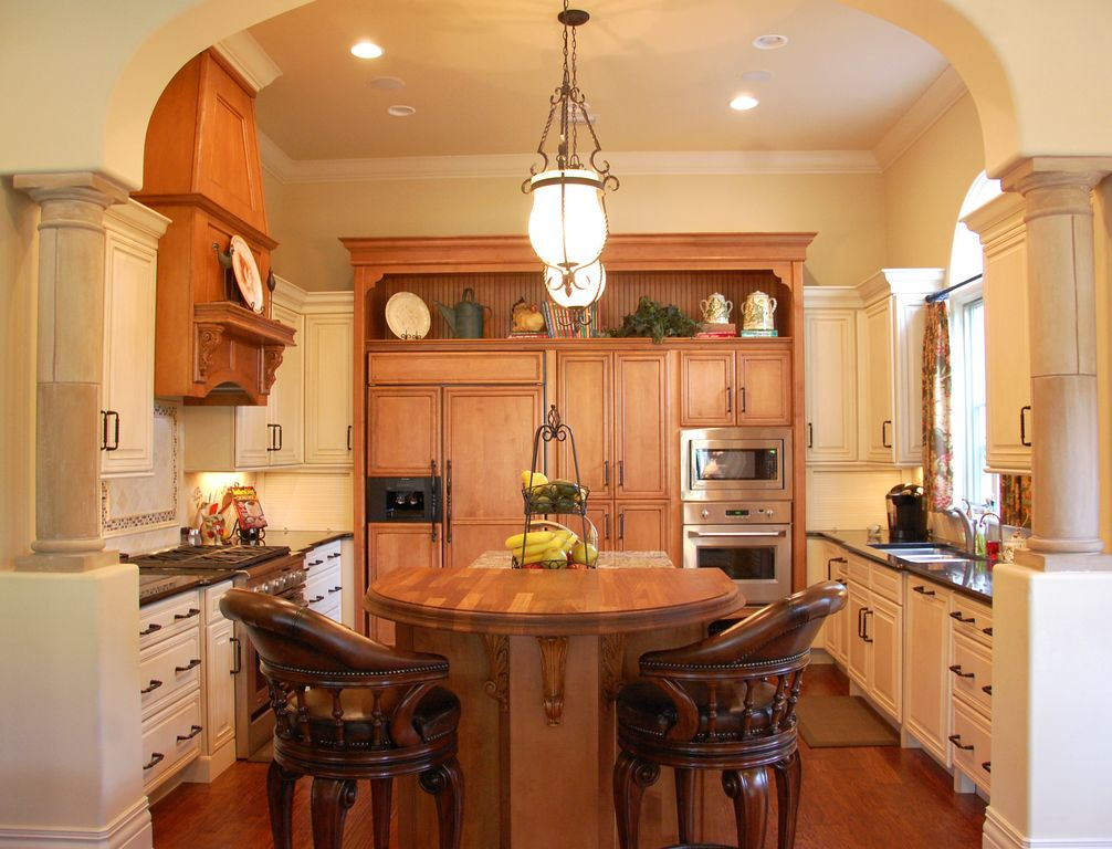 Traditional Kitchen with Pendant light, Columns, Cathedral ceiling, Crown molding, Large Ceramic Tile, Soapstone counters