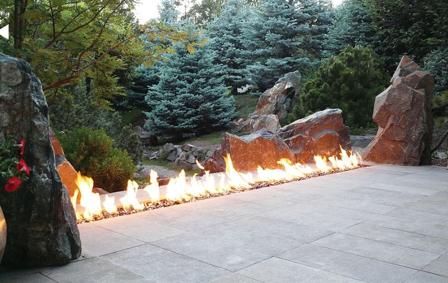 Traditional Landscape/Yard with Modern outdoor fire pit, Outdoor tile