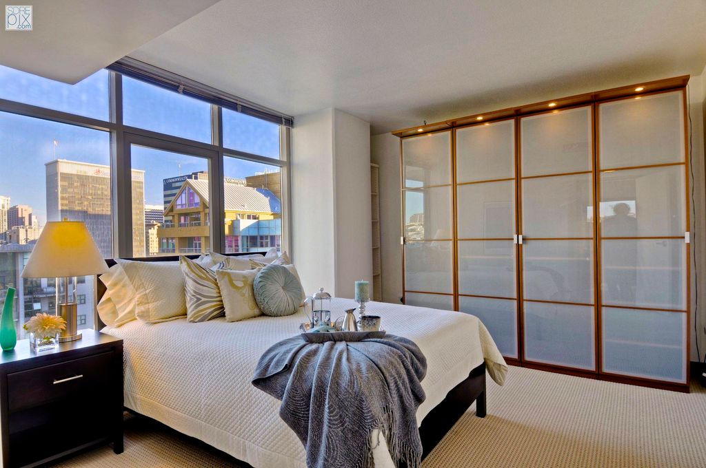 Modern Master Bedroom with can lights, picture window, Black platform bed, Asher 2-drawer nightstand, Built-in bookshelf