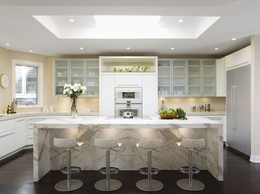 Contemporary Kitchen with Built In Refrigerator, Complex marble counters, double wall oven, Corian counters, electric cooktop