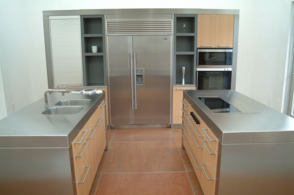 Contemporary Kitchen with Flush, Stainless steel counters, Kitchen island, sandstone tile floors, European Cabinets, One-wall