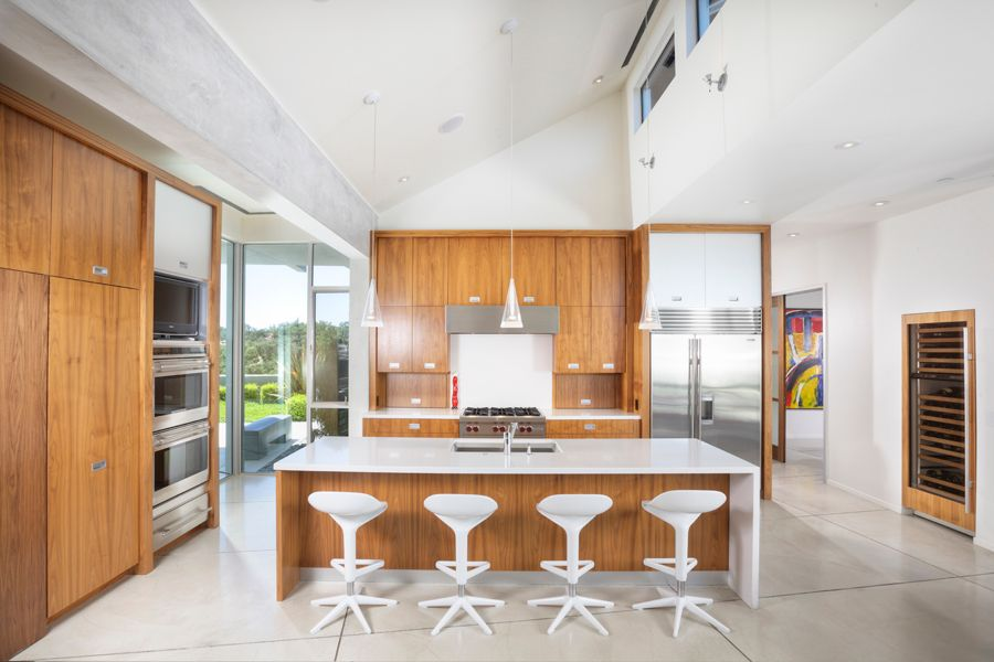 Modern Kitchen with Built In Refrigerator, Breakfast bar, double wall oven, can lights, full backsplash, Flush, High ceiling