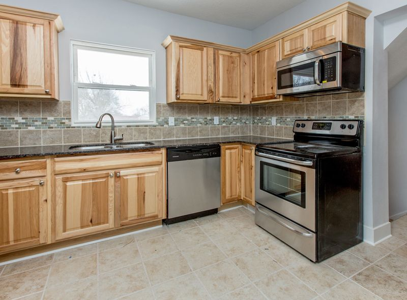 Modern Kitchen with gas range, Raised panel, Large Ceramic Tile, Multiple Sinks, L-shaped, double-hung window, Paint