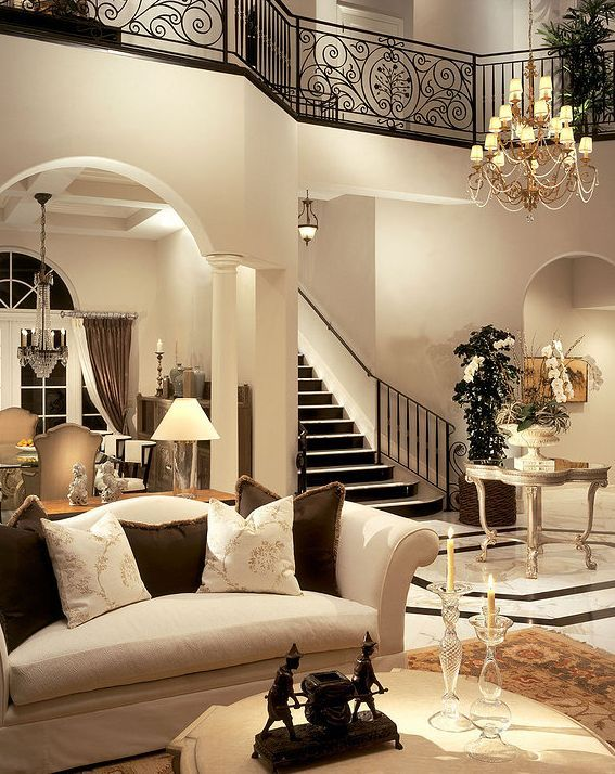 Traditional Living Room with Balcony, West Elm Low bone coffee table, High ceiling, Paint, Chandelier, Columns