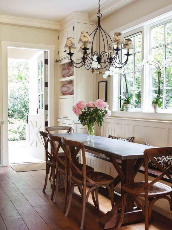 Country Dining Room with Crown molding, Chandelier, Window seat, Built-in bookshelf, Hardwood floors, Dutch door