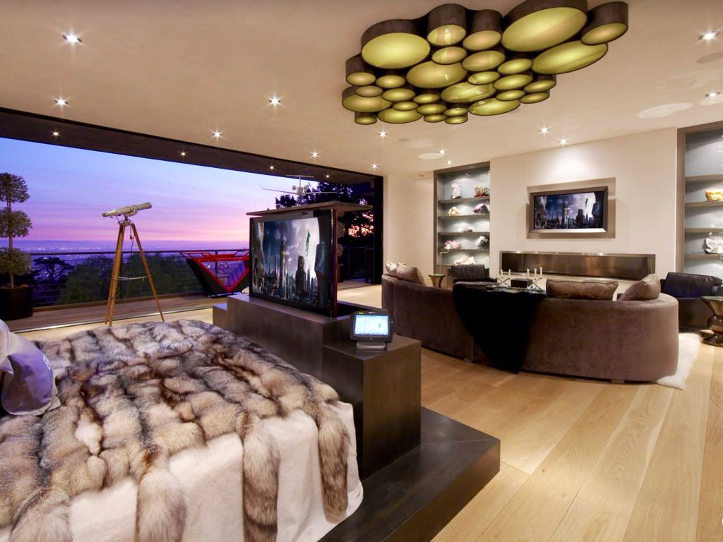 Contemporary Master Bedroom with Standard height, Chandelier, Built-in bookshelf, can lights, Hardwood floors