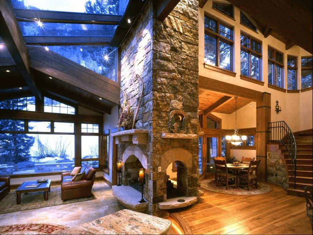Rustic Living Room with High ceiling, stone fireplace, Stone mantel, specialty window, Exposed beam, Wall sconce, Chandelier