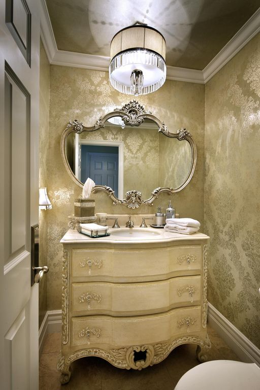 Traditional Powder Room with flush light, Inset cabinets, Crown molding, Simple marble counters, Ornate carved mirror