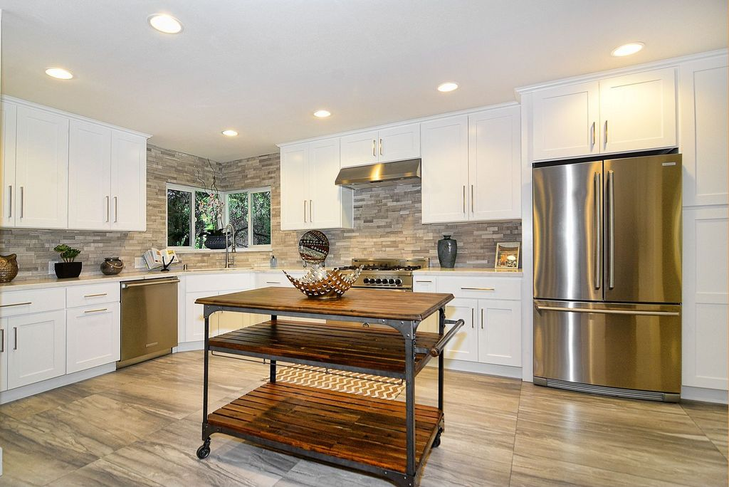 Contemporary Kitchen with full backsplash, dishwasher, electric cooktop, stone tile floors, Inset cabinets, European Cabinets