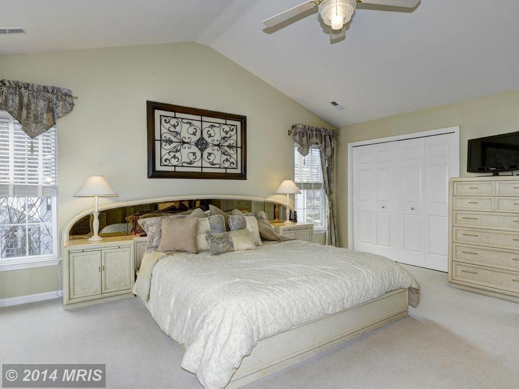Traditional Master Bedroom with Built-in bookshelf, Ceiling fan, Carpet