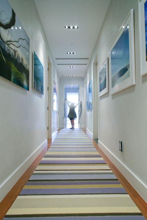 Modern Hallway with Hardwood floors, can lights, Standard height